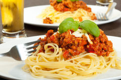 Spaghetti bolognese with glass of beer Stock Photo