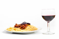 Spaghetti bolognese with a glass of wine Stock Images