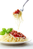 Spaghetti bolognese and green basil leaf Royalty Free Stock Images