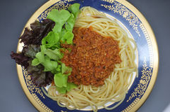 Spaghetti Bolognese, meat tomato sauce with lettuce Royalty Free Stock Photos