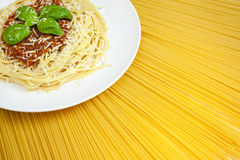 Spaghetti Bolognese On Display Of Dried Pasta Stock Photos