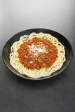 Spaghetti Bolognese with Parmesan on Dark Background Vertical Royalty Free Stock Images