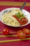 Spaghetti bolognese with  parsley garnish Royalty Free Stock Photos