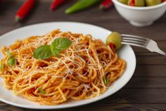 Spaghetti bolognese pasta with tomato sauce and minced meat, grated parmesan cheese and fresh basil stock photography