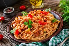 Spaghetti bolognese pasta with tomato sauce, vegetables and minced meat. Homemade healthy italian pasta on rustic wooden background stock photo