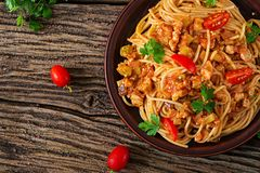 Spaghetti bolognese pasta with tomato sauce, vegetables and minced meat. Homemade healthy italian pasta on rustic wooden background. Top view. Flat lay royalty free stock photos