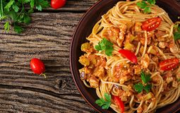 Spaghetti bolognese pasta with tomato sauce, vegetables and minced meat. Homemade healthy italian pasta on rustic wooden background. Top view. Flat lay stock photo