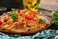 Spaghetti bolognese pasta with tomato sauce, vegetables and minced meat. Homemade healthy italian pasta on rustic wooden background stock images