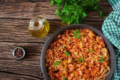Spaghetti bolognese pasta with tomato sauce, vegetables and minced meat. Homemade healthy italian pasta on rustic wooden background. Top view. Flat lay stock photography