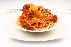 Spaghetti bolognese on a plate being eaten Stock Photo