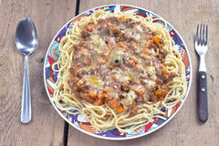 Spaghetti bolognese on plate with fork and spoon Stock Photo