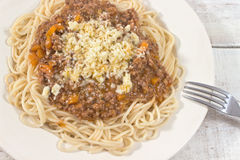 Spaghetti bolognese on plate with fork Stock Photography