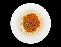 Spaghetti bolognese with pork or meat tomato sauce on a plate isolated on the black background with clipping path Royalty Free Stock Photo