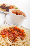 Spaghetti bolognese and a sauce boat Royalty Free Stock Photos