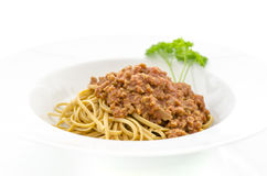 Spaghetti bolognese. Served in large white plate. Isolated over white background Stock Image