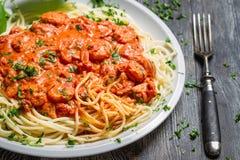Spaghetti bolognese with shrimp and basil Stock Photos