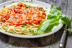 Spaghetti bolognese with shrimps and basil Stock Photo