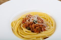 Spaghetti bolognese. With parmesan and basil leaves Royalty Free Stock Photography