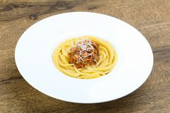 Spaghetti bolognese. With parmesan and basil leaves Stock Images