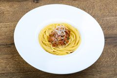 Spaghetti bolognese. With parmesan and basil leaves Stock Photo