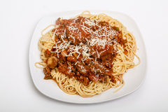 Spaghetti Bolognese in Square White Plate Royalty Free Stock Image