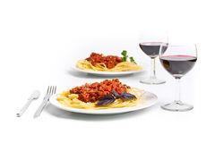 Spaghetti bolognese with two glasses of wine Stock Images