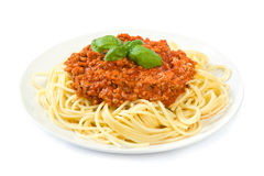 Spaghetti bolognese on white. A whole plate of spaghetti bolognese isolated on white Royalty Free Stock Photos