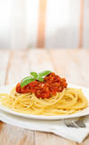 Spaghetti Bolognese on white plate Stock Photos
