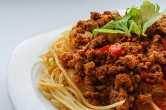 Spaghetti Bolognese. On a white plate Royalty Free Stock Photo