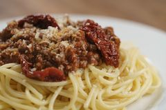 Spaghetti bolognese on white plate closeup. Shallow focus Royalty Free Stock Image