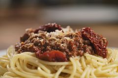Spaghetti bolognese on white plate closeup. Shallow focus Royalty Free Stock Photos