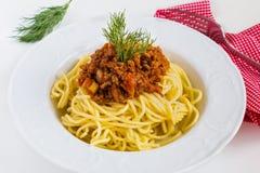 Spaghetti bolognese on white plate. On white table Stock Image