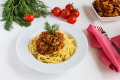 Spaghetti bolognese on white plate. On white table Stock Images