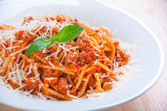 Spaghetti bolognese on white plate with tomato sauce and basi Royalty Free Stock Photography