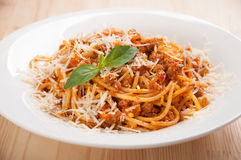 Spaghetti bolognese on white plate with tomato sauce and basil Stock Image