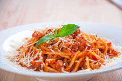 Spaghetti bolognese on white plate with tomato sauce Stock Image
