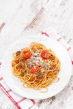Spaghetti bolognese on a white plate, top view Stock Photo