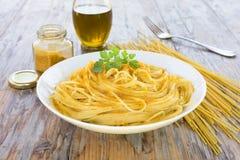 Spaghetti with bottarga on wooden table Stock Images