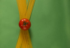 Spaghetti bow. Long spaghetti with tomato in the middle Royalty Free Stock Images