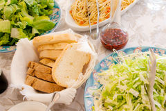 Spaghetti with bread and salad Royalty Free Stock Photo