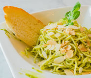 Spaghetti. With bread in white dish on the stone table Royalty Free Stock Image