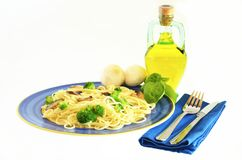 Spaghetti and broccoli. On a plate Royalty Free Stock Photography