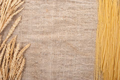 Spaghetti on the burlap background Stock Images