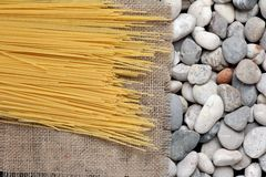 Spaghetti on Burlap fray Royalty Free Stock Images