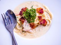 Spaghetti cabana. With White Sauce on white dish at restaurant stock images