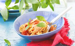 Spaghetti with calamary tomatoes and basil Royalty Free Stock Photo