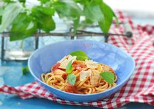 Spaghetti with calamary tomatoes and basil Stock Image
