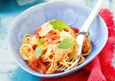 Spaghetti with calamary tomatoes and basil Royalty Free Stock Images