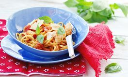 Spaghetti with calamary tomatoes and basil Stock Photos