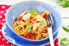 Spaghetti with calamary tomatoes and basil Stock Photo